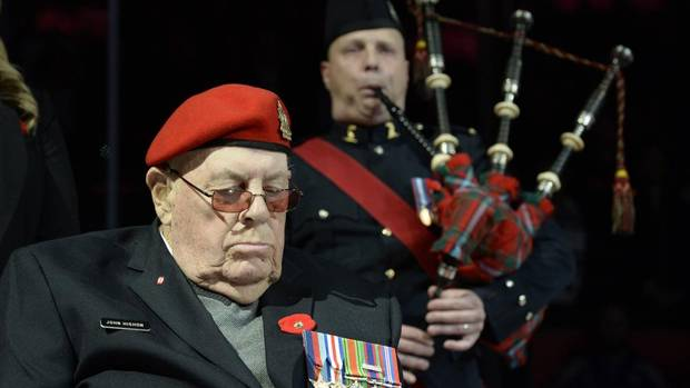 "Second World War veteran John Hishon hangs his head during the playing of "" ""Amazing Grace"" during pre-game ceremonies before NHL action between the New Jersey Devils and Toronto Maple Leafs in Toronto on Friday, Nov. 8, 2013. (FRANK GUNN/THE CANADIAN PRESS)"