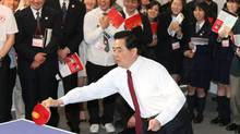Chinese president Hu Jintao plays table tennis at Waseda University's Okuma Garden House on May 8, 2008 in Tokyo, Japan. (Koichi Kamoshida/2008 Getty Images)