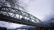 A heavy truck crosses the Kitimat River (Haisla Blvd) bridge Feb. 20, 2014. (Robin Rowland for the Globe and Mail)