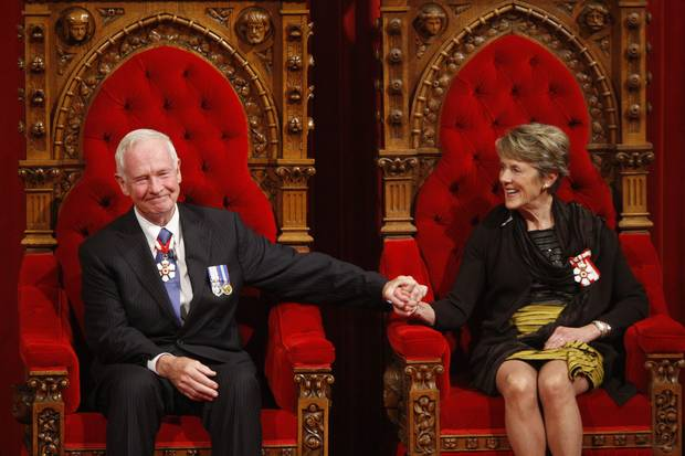 Oct. 1, 2010: Mr. Johnston and his wife, Sharon, sit on the throne after his swearing-in.