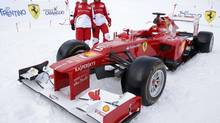 Ferrari Formula One driver Fernando Alonso of Spain and Felipe Massa of Brazil pose with a Ferrari F2012 model during Ferrari's annual media gathering in Madonna di Campiglio (MAX ROSSI/Reuters)