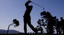 Silhouette of a golfer (Eric Risberg/Associated Press)