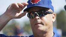 Toronto Blue Jays manager John Gibbons adjusts his cap before a spring training baseball game against the Houston Astros in Kissimmee, Fla., Sunday, March 9. (Carlos Osorio/AP)