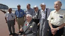 Canadian veterans, from left, David Hart, Ray Gilbert, Roman Wozniak, Charles Burrows, Arthur Rossell, Frederick Engelbrecht  and Donatien Vaillancourt, seated, at the beach in Dieppe, France, Aug. 17, 2012. (SAM DUBLIN For The Globe and Mail)