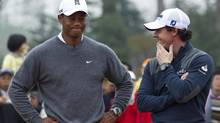 Tiger Woods and Rory McIlroy (Alexander F. Yuan/The Associated Press)