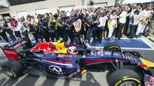 Red Bull driver Daniel Ricciardo from Australia passes his crew as he arrives in pit lane after winning the Canadian Grand Prix at Circuit Gilles Villeneuve, Sunday, June 8, 2014 in Montreal. (Ryan Remiorz/THE CANADIAN PRESS)