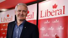 Liberal member of Parliament Marc Garneau smiles as he announces his run for the leadership of the federal Liberal party during a news conference in Montreal, Nov. 28, 2012. (CHRISTINNE MUSCHI/REUTERS)