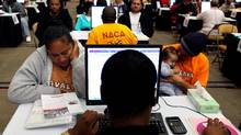 Thousands attend a mobile foreclosure prevention clinic in Daly City, Calif. (Justin Sullivan/Getty Images)