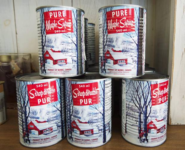 Maple syrup cans are seen at a sugar shack in Oka, Quebec.