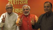 (From L - R) India's main opposition Hindu-nationalist Bharatiya Janata Party (BJP) leader Lal Krishna Advani, Gujarat's chief minister and Hindu nationalist Narendra Modi, the prime ministerial candidate for BJP and leader Arun Jaitley show victory signs before their meeting in New Delhi December 8, 2013. (AHMAD MASOOD/REUTERS)