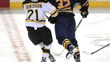 Buffalo's John Scott faces a league hearing Thursday for this head shot on Boston's Loui Eriksson. (Harry Scull Jr./AP)