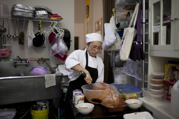 Chanpen Thangtong prepares Hoh Mok, a curry fish custard, for the daily lunch special at Patchmon's Thai Desserts.