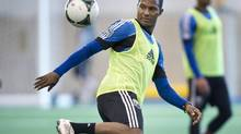 Montreal Impact Patrice Bernier plays with a ball during the first day of training camp Montreal, Monday, January 21, 2013. (Paul Chiasson/THE CANADIAN PRESS)