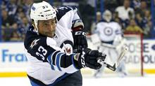 Winnipeg Jets' Dustin Byfuglien follows through on a shot during the first period Feb. 2, 2012. (Mike Carlson/Associated Press/Mike Carlson/Associated Press)