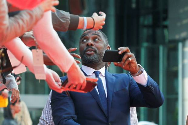 Idris Elba greets fans at the premiere of The Mountain Between Us.