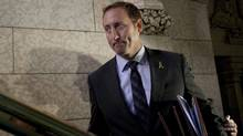 Minister of National Defence Peter MacKay leaves the House of Commons after speaking with the media on Parliament Hill in Ottawa, Thursday September 29, 2011. (Adrian Wyld/THE CANADIAN PRESS)