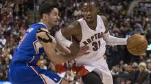 Toronto Raptors' Terrence Ross (right) drives past Los Angeles Clippers' J.J. Redick during second half NBA basketball action in Toronto on Saturday January 25 , 2014. (Chris Young/THE CANADIAN PRESS)