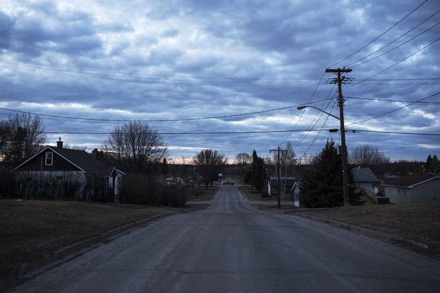 A truck drives down a lonely road in Dryden. The community is one of many in northern and northwestern Ontario where Indigenous people, moving to urban centres in hopes of better lives, grow the economies of otherwise struggling cities.