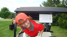 Liam Delaney, 10, participates in the Sean Delaney Memorial Golf Classic in honour of his father, who died after eating a dish that contained peanuts.