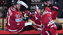 Canada's Jordan Staal, right, celebrates with teammate Steven Stamkos after he scored the third goal against Sweden during second period preliminary round action Thursday, May 9, 2013 at the world hockey championship in Stockholm, Sweden. (Jacques Boissinot/THE CANADIAN PRESS)