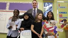 Glenn Hadden with (from left) Donae Baker, Baneen Kazmi, Justyne Martin and Batul Naqvi at Cedar Drive Junior Public School. (Moe Doiron/The Globe and Mail)