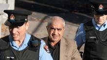 Mohammad Shafia is led into court in Kingston Ontario on Tuesday October 11, 2011. (Lars Hagberg/Lars Hagberg/The Canadian Press)