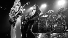 Alex Lifeson and Geddy Lee in a scene from the documentary Rush: Beyond the Lighted Stage.