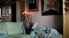 Jazmina Ramzy reads in her downtown Toronto apartment on Jan. 25, 2012. (Fernando Morales/The Globe and Mail)