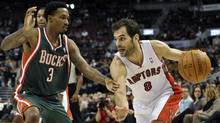 Toronto Raptors guard Jose Calderon goes to the basket against Milwaukee Bucks guard Brandon Jennings (L) during the first half of their NBA basketball game in Toronto February 8, 2012. (MIKE CASSESE/REUTERS)