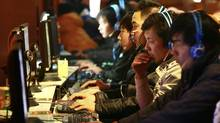 In this photo taken Friday, Jan. 15, 2010, Chinese use computers at an Internet cafe in Fuyang in central China's Anhui province. (AP)