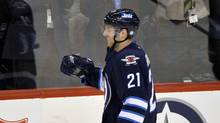 Winnipeg Jets' Aaron Gagnon celebrates his first career goal against the Buffalo Sabres during the second period of their NHL game in Winnipeg April 9, 2013. (FRED GREENSLADE/REUTERS)
