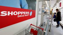 A customer enters a Shoppers Drug Mart in Toronto on Feb. 7, 2011. (Deborah Baic/Deborah Baic/The Globe and Mail)