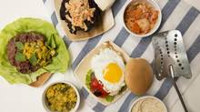 A Lucy Waverman food dish photographed in Toronto, Ontario on July 3, 2014. Three types of burgers, Malaysian, at left with lettuce; Peruvian, centre, with egg and roasted pepper; and Korean, topped with kimchi, top. (Peter Power for The Globe and Mail)
