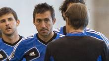 Montreal Impact's Davy Arnaud, (2nd left) listens to head coach Jesse Marsch, as he talks with players during a training session in Montreal, Tuesday, March 6, 2012. The Impact will play their first game as an MLS team in Vancouver on Saturday. THE CANADIAN PRESS/Graham Hughes (Graham Hughes/CP)