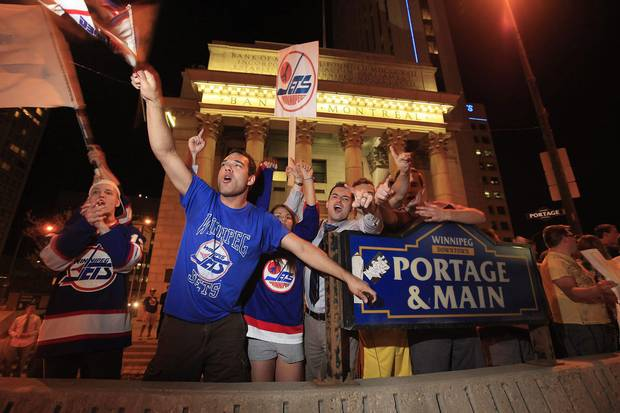 2011: Hockey fans celebrate at Portage and Main after reading a report in The Globe and Mail that an NHL team maybe returning to Winnipeg.