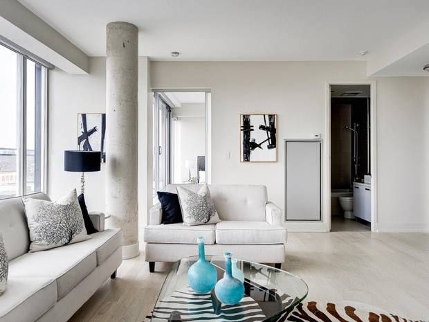 Smooth ceilings make the room feel less industrial than a 'hard' loft.