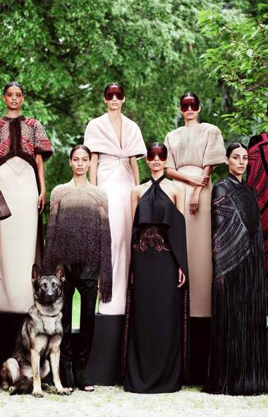 For several seasons now, Givenchy's Riccardo Tisci has enlisted Willy Vanderperre to shoot a portrait for his haute couture collection. In conceiving the Fall collection, Tisci drew from disparate references: a certain gypsy decadence combined with streamlined 1960s silhouettes. Tisci deliberately selected 10 black models plus one German shepherd.