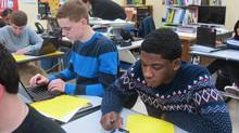 Students use the internet in a classroom. (Dinesh Ramde/The Associated Press)