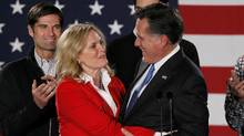 Republican presidential candidate and former Massachusetts Governor Mitt Romney hugs his wife Ann as his sons look on at his Iowa Caucus night rally in Des Moines, Iowa, January 3, 2012. (RICK WILKING/Rick Wilking/Reuters)