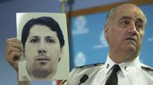 Police chief Julian Fantino holds a photo of Holly Jones' murderer Michael Briere during a press conference on June 23, 2003. (Fred Lum/The Globe and Mail)