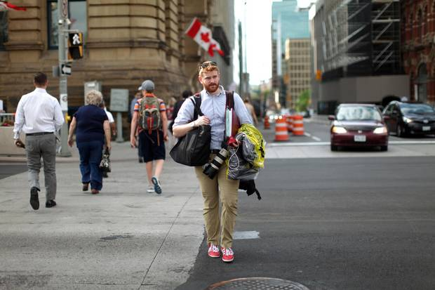 Photographer Adam Scotti on his way to work on Parliament Hill: But for an affection for craft beer (which he tracks with a smartphone app), he lives a spartan life.