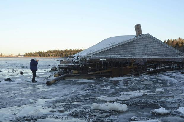 This century-old McCurdy's Smokehouse brining shed was swept on to the beach at Campobello Island, N.B., from Lubec, Me.