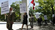 Foreign service officers protest in front of the Canadian embassy in Washington in May. (Charles Dharapak/Associated Press)