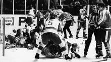 Soviet Union and Canadian players during second period bench-clearing brawl at the World Junior Hockey Championships here Jan. 5, 1987. Both teams were ejected from the tournament. While the Soviets were out of medal contention, Canada was playing for the gold medal, and were leading 4-2 at the time of the brawl . (AP)