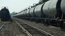 Rail exports are up, but less than 5 per cent of Canada's crude oil is moved that way. LJP04- Dozens of tanker cars similar to the model used for the train that crashed in Lac-Megantic, Que., are parked on Monday, July 16, on the train's line near Farnham, Que. The derailment means the MMA railway can't move the oil to its destination in Saint John, NB. (Les Perreaux/The Globe and Mail)