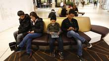 WiFi now accounts for about 78 per cent of the data consumed on smartphones, according to a new international report by consultancies Mobidia Technology and Informa Telecoms & Media. (Todd Korol For The Globe and Mail)