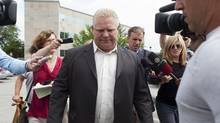 Councillor Doug Ford is followed by the media as he leaves the Etobicoke Civic Centre on Tuesday, August 12, 2014.