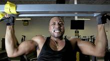 Singer-songwriter Dru does pull-ups during a workout with personal trainer Rommel Oliveros at Evolution Martial Arts Fitness Academy in Mississauga. (Matthew Sherwood For The Globe and Mail)