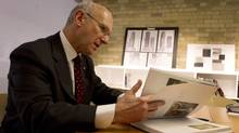 David Mirvish reads in his King Street office in Toronto on Friday. (Peter Power/The Globe and Mail)