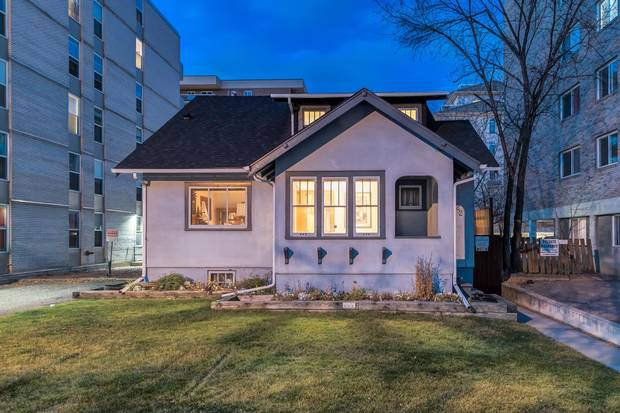 Home of Beverley Downey at 1322 13th Ave. in Calgary's Beltline district. The tiny home amid a sea of high- and mid-rise development is currently for sale.